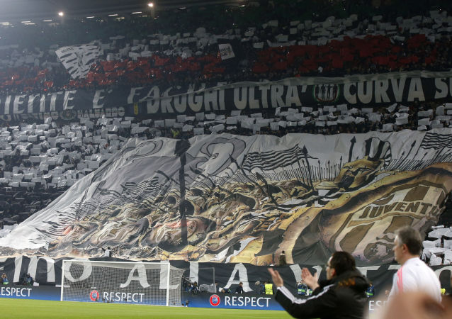 Juventus fans unveil a giant banner prior to the Champions League, round of 16, first-leg soccer match between Juventus and Bayern Munich at the Juventus stadium in Turin, Italy.