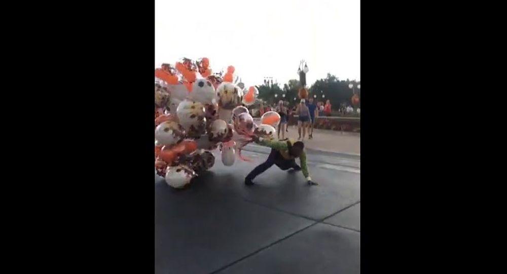 Balloon vendor almost takes flight at Disney