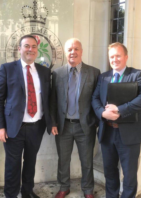 Raymond McCord senior (pictured, centre) at the UK Supreme Court