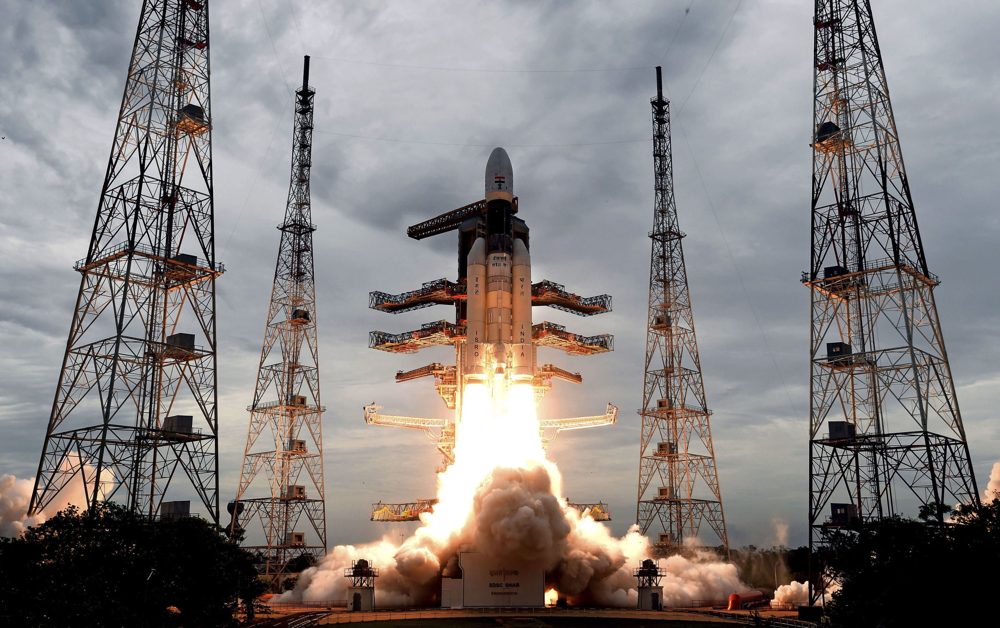 This photo released by the Indian Space Research Organization (ISRO) shows its Geosynchronous Satellite launch Vehicle (GSLV) MkIII carrying Chandrayaan-2 lift off from Satish Dhawan Space center in Sriharikota, India, Monday, July 22, 2019