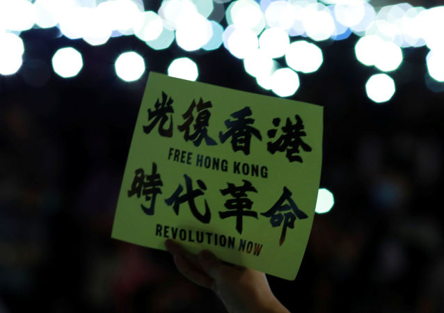 An anti-government protester holds a placard during a rally at Edinburgh Place to show solidarity for arrested political activists being held at San Uk Ling detention centre in Hong Kong, China 27 September 2019.