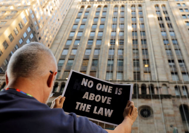 Demonstrators hold protest signs as part of a demonstration in support of impeachment hearings in New York, U.S., September 26, 2019.