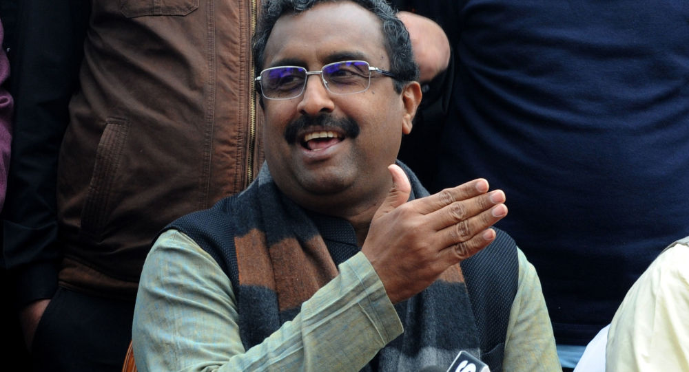 Bharatiya Janata Party (BJP) national general secretary Ram Madhav gestures as he speaks during a press conference at a hotel ahead of India's general election, in Srinagar on March 27, 2019