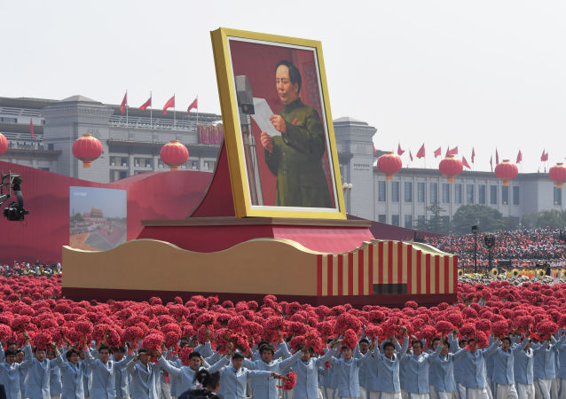 A giant portrait of former Chinese Communist Party leader Mao Zedong passes by Tiananmen Square during the National Day parade in Beijing on October 1, 2019, to mark the 70th anniversary of the founding of the People's Republic of China.