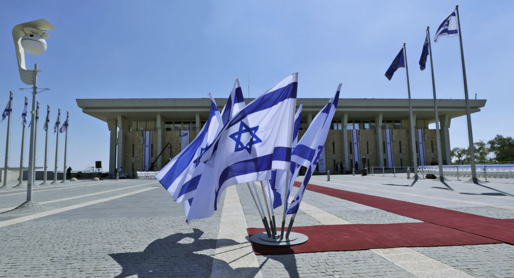 This picture taken on October 3, 2019 shows Israeli flags flying outside the Knesset (Israeli parliament) headquarters in Jerusalem