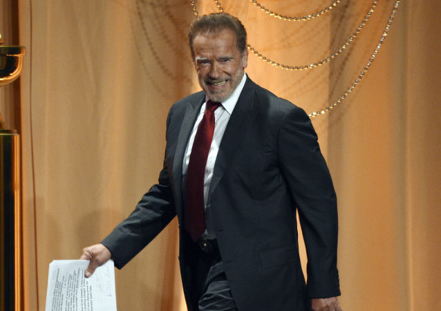 Host Arnold Schwarzenegger arrives onstage at the 2019 Hollywood Foreign Press Association's Annual Grants Banquet at the Beverly Wilshire Hotel, 31 July 2019, in Beverly Hills, California.