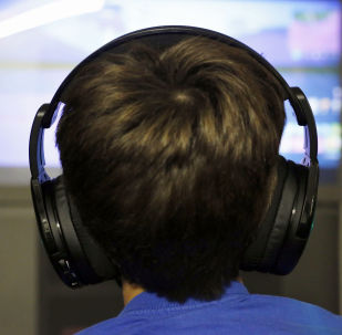 """In this Oct. 6, 2018, file photo Henry Hailey, 10, plays one of the online Fortnite game in the early morning hours in the basement of his Chicago home. Fortnite, a free-to-play game that has become a massive hit with its """"battle royal"""" mode winning over millions of fans."""