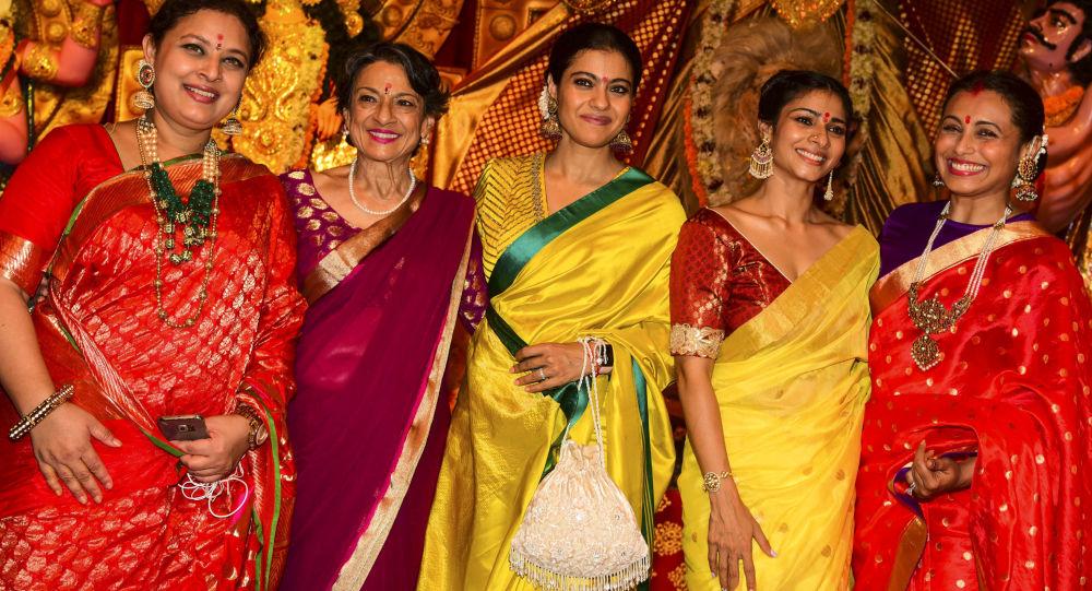 Bollywood actresses Sharbani Mukherjee (L), Tanuja (2L), Kajol Devgan (C), Tanisha Mukherjee (2R) and Rani Mukherjee (R) pose for photographs during 'Durja Puja' celebrations at the 72nd North Bombay Sarbojanin Durga Puja Samiti festival in Mumbai on October 6, 2019.