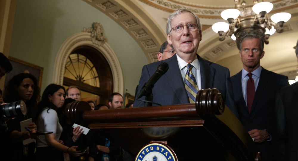 Republican Senate Majority Leader Mitch McConnell of Kentucky smiles as he speaks to members of the media, next to South Dakota Republican Senator John Thune, right, on 24 September 2019 after a GOP policy luncheon on Capitol Hill in Washington.