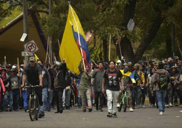 Protestors march in Quito on October 8, 2019 following days of protests against the sharp rise in fuel prices sparked by authorities' decision to scrap subsidies.