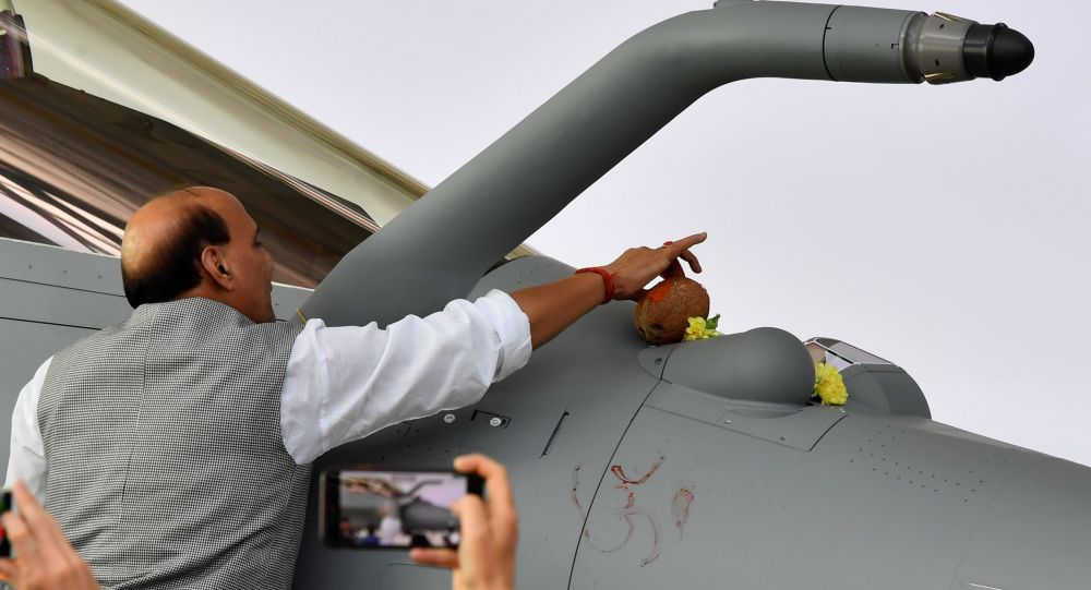 Indian Defence minister Rajnath Singh inaugurates the first of 36 Rafale fighter jets destined for India during the delivery ceremony, on October 8, 2019 at Dassault Aviation plant in Merignac.