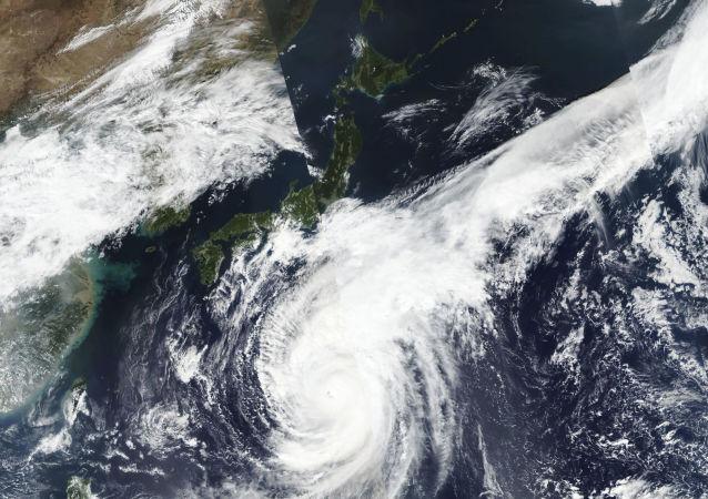 satellite photo taken by NASA-NOAA's Suomi NPP satellite shows typhoon Hagibis approaching Japan