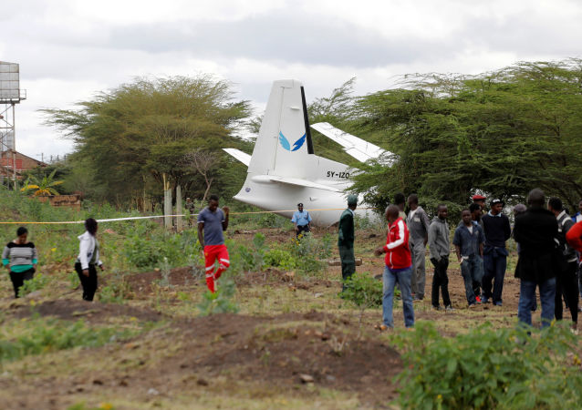 Bystanders watch the Fokker 50, 5Y-IZO plane operated by Silverstone Air that crash landed after take-off from the Wilson Airport in Nairobi, Kenya October 11, 2019