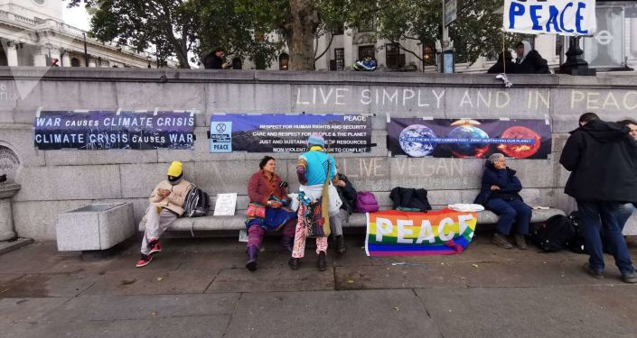 Activists from the Extinction Rebellion (XR) Peace group sit with banners at Trafalgar Square in London, UK on Friday, 11 October 2019