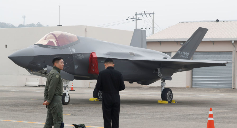 A South Korean fighter pilot (L) stands next to his F-35 stealth fighter during a ceremony to mark the 71st Armed Forces Day at the Air Force Base in Daegu, South Korea, October 1, 2019