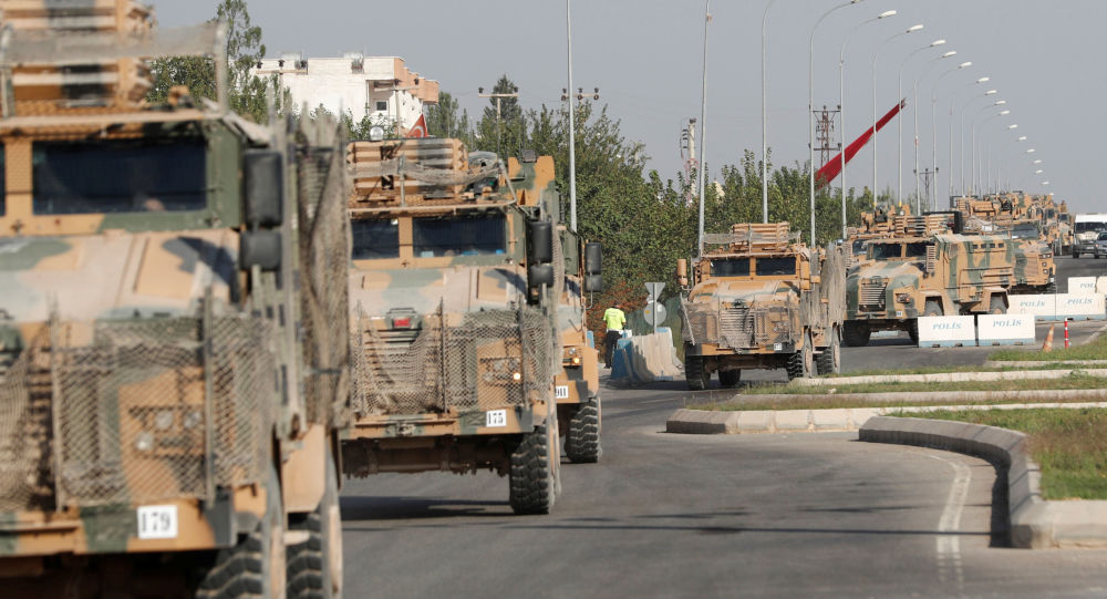 Turkey says troops captured Syrian border town