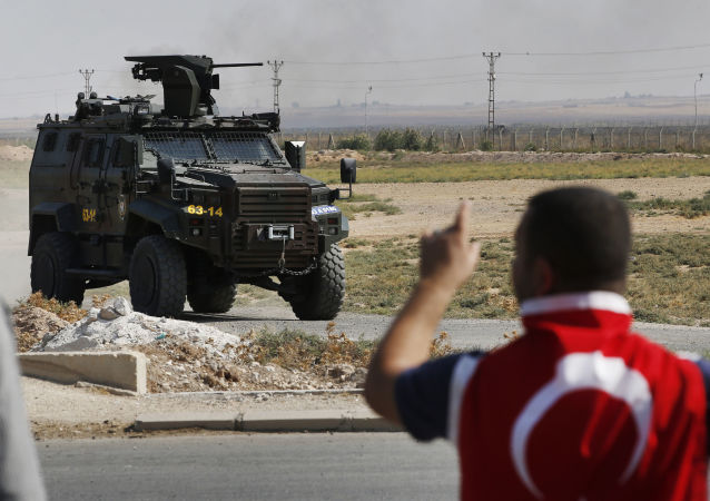 A Turkish police armoured vehicle patrols the border between Turkey and Syria in Akcakale, Sanliurfa province, southeastern Turkey