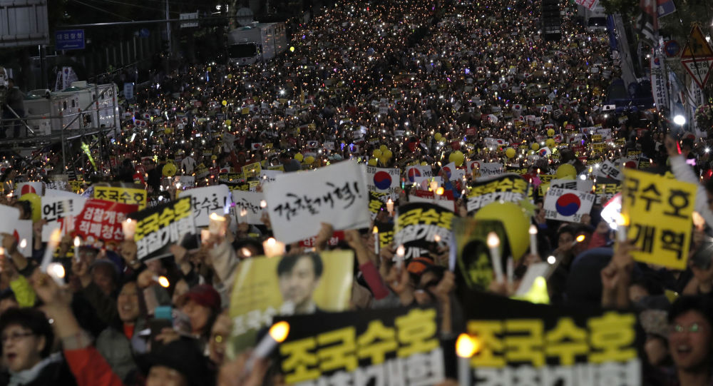Pro-government supporters hold candles during a rally supporting Justice Minister Cho Kuk in Seoul