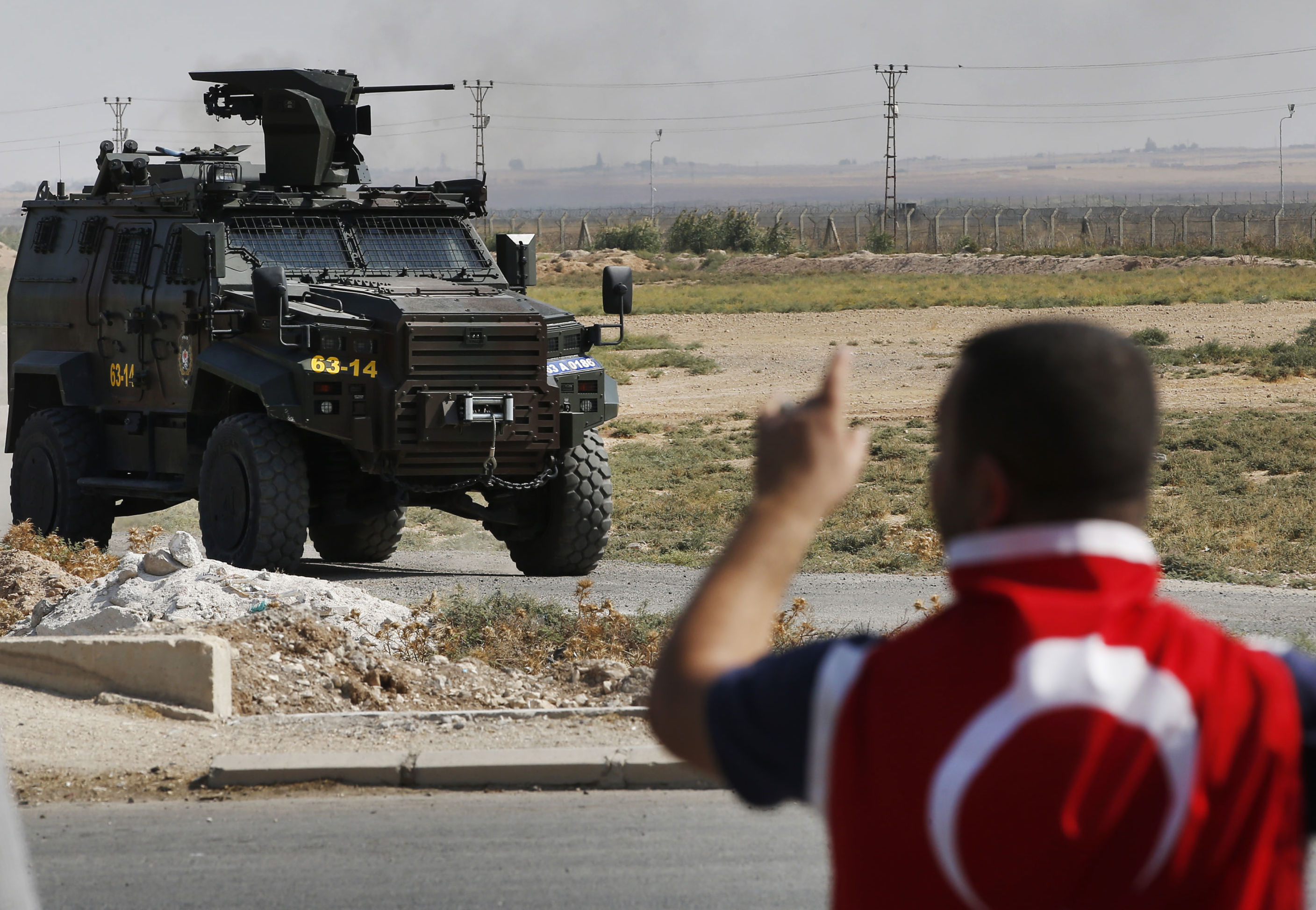 A Turkish police armoured vehicle patrols the border between Turkey and Syria, in Akcakale, Sanliurfa province, southeastern Turkey