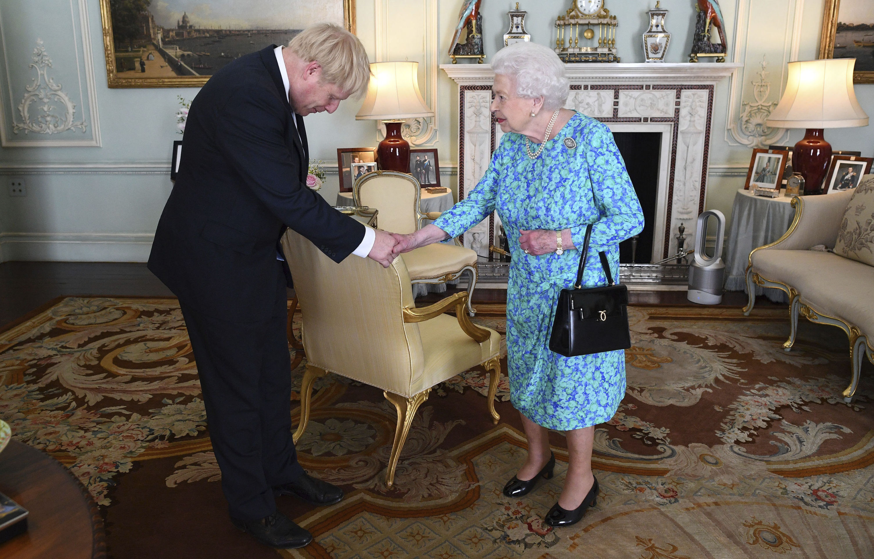 Britain's Queen Elizabeth II welcomes newly elected leader of the Conservative party Boris Johnson during an audience at Buckingham Palace, London, Wednesday July 24, 2019, where she invited him to become Prime Minister and form a new government