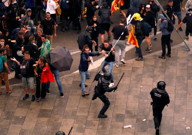 Protesters clash with police during a demonstration at Barcelona's airport, after a verdict in a trial over a banned independence referendum, Spain October 14, 2019
