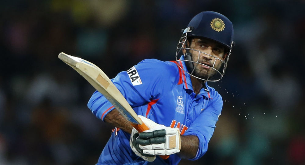 India's batsman Irfan Pathan plays a shot during the ICC Twenty20 Cricket World Cup Super Eight match against Australia in Colombo, Sri Lanka, Friday, Sept. 28, 2012