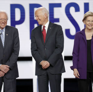 Democratic presidential candidate Sen. Bernie Sanders, I-Vt., former Vice President Joe Biden, center, and Sen. Elizabeth Warren, D-Mass., right, stand on stage before a Democratic presidential primary debate hosted by CNN and The New York Times at Otterbein University, Tuesday, Oct. 15, 2019, in Westerville, Ohio.
