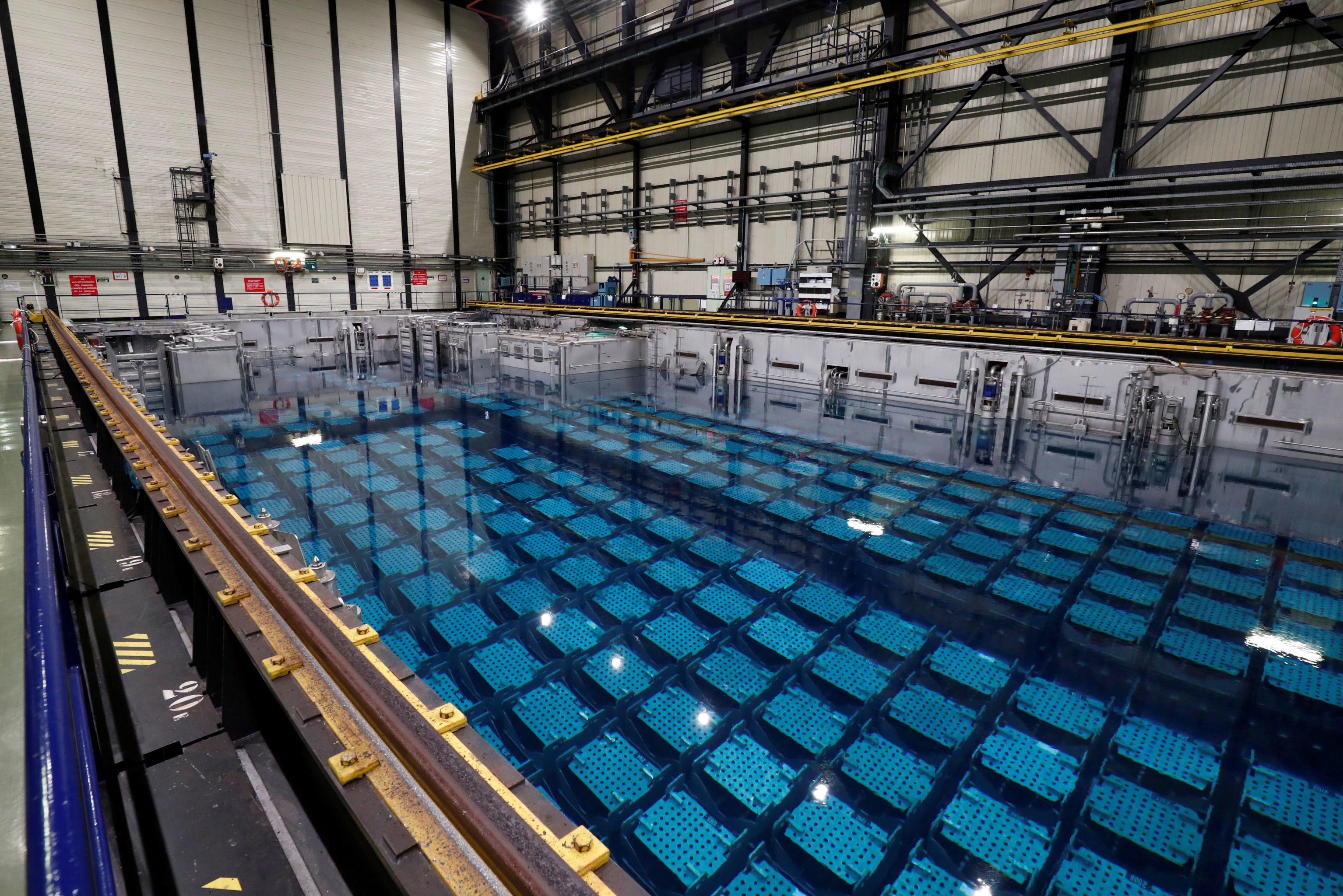 Used nuclear fuel is seen in a storage pool at the Orano reprocessing plant in La Hague
