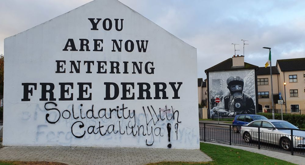 Free Derry Corner in Northern Ireland in October 2019, daubed with fresh graffiti supporting the Catalan pro-independence movement