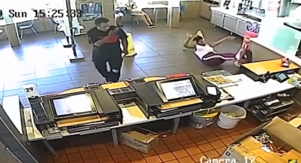 Surveillance footage captures the moment that former McDonald's manager Nashawnda Johnson throws a blender at customer Britany Price after the diner throws food at her.
