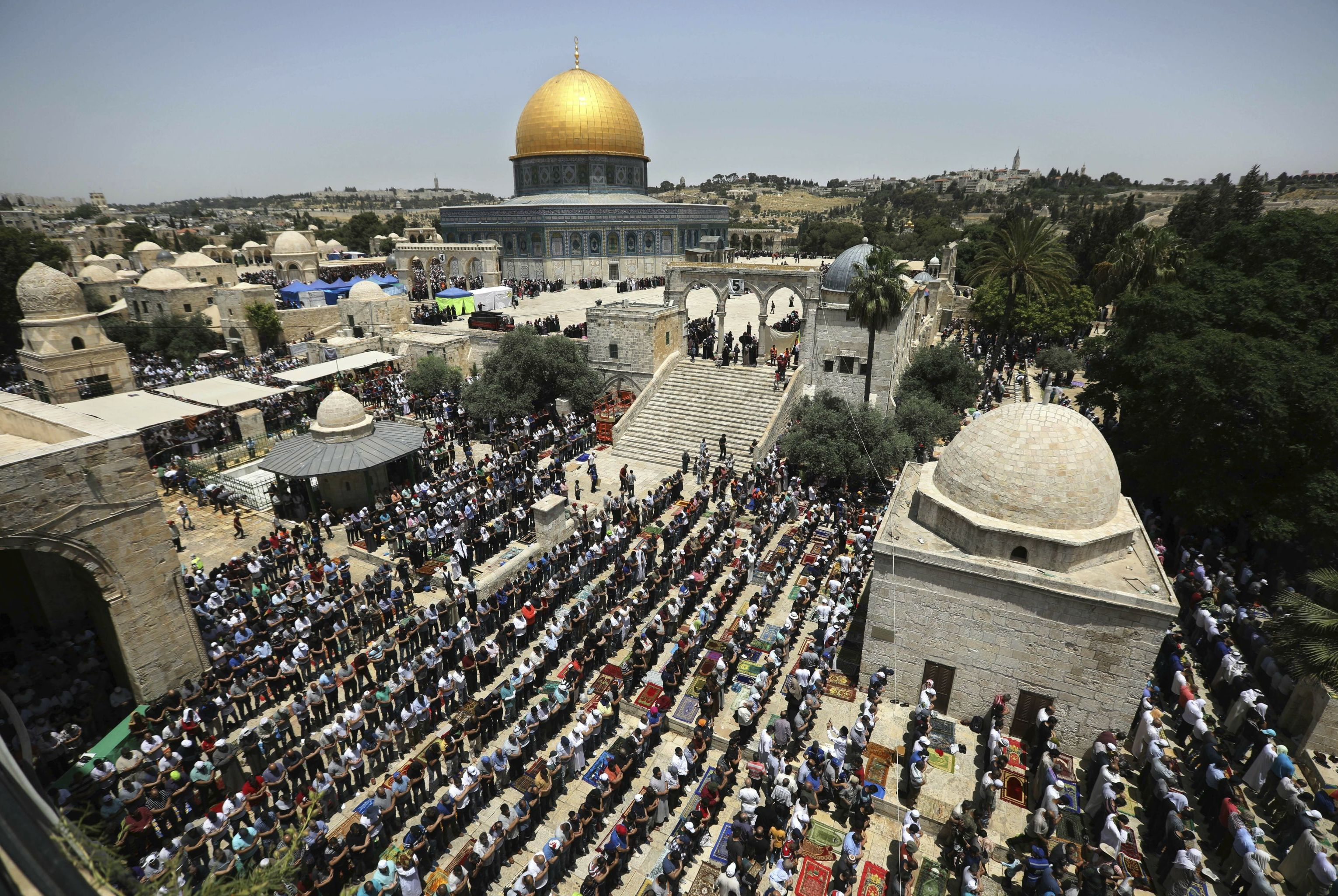 Palestinian worshipers pray during the last Friday of the holy month of Ramadan at the Al Aqsa Mosque compound in Jerusalem's old city