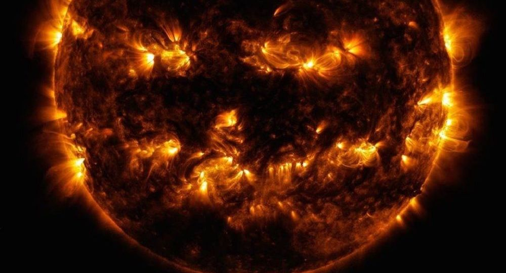 Even our star celebrates the spooky season — in 2014, active regions on the Sun created this jack-o'-lantern face, as seen in ultraviolet light by our Solar Dynamics Observatory satellite
