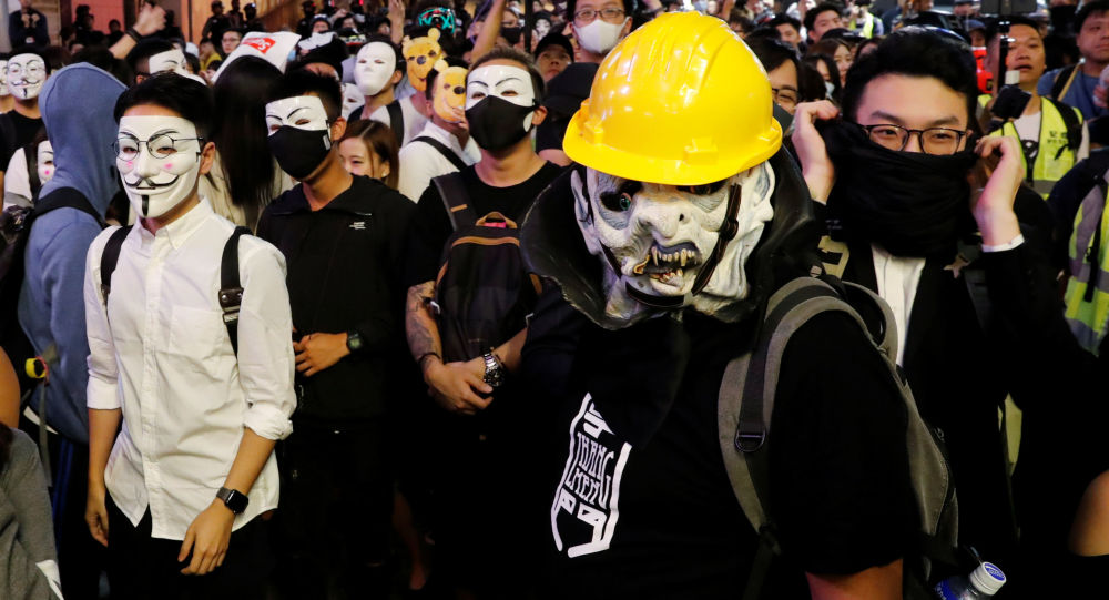 Anti-government protesters wear Guy Fawkes masks during a Halloween march in Lan Kwai Fong, Central district, Hong Kong, China October 31, 2019