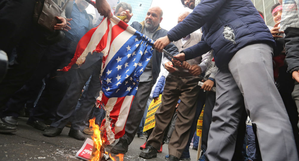 Iranian protesters set a US flag on fire during a rally outside the former US embassy in the Iranian capital Tehran on November 4, 2019, to mark the 40th anniversary of the Iran hostage crisis.