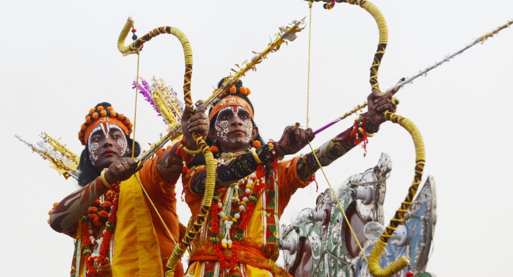 Indian Hindu devotees dressed as the lord Ram (C) and Laxman (L) take part in a religious procession on the occasion of the Hindu festival of Dussehra in Amritsar on October 8, 2019