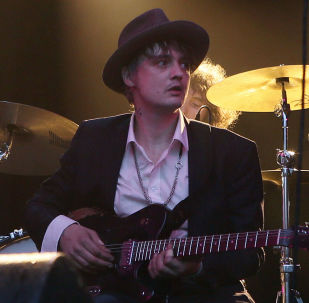 FILE - In this May 4, 2017 file photo, British musician Pete Doherty performs on stage during a concert in Paris. Paris authorities say British singer Pete Doherty has been arrested in Paris for buying drugs