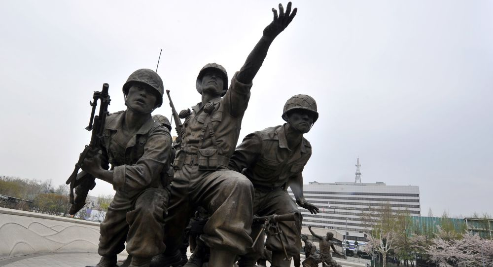 South Korean's Defence Ministry building (R) is seen behind the monument in remembrance of the Korean War, in Seoul on April 23, 2013