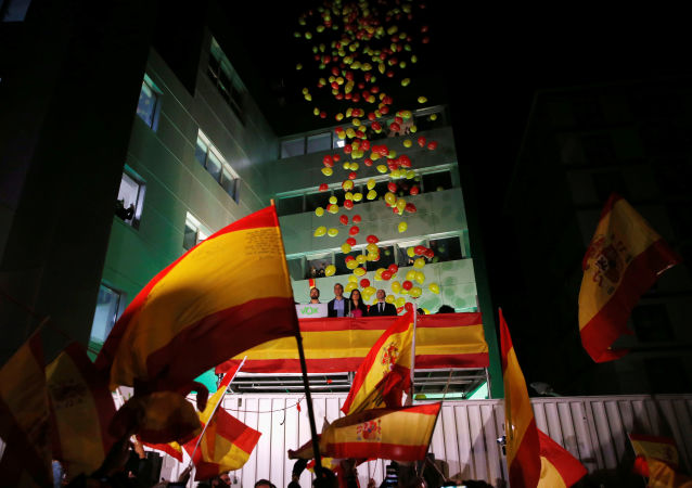 Supporters react with VOX candidate Santiago Abascal during Spain's general election at the party headquarters in Madrid, Spain, November 10, 2019.