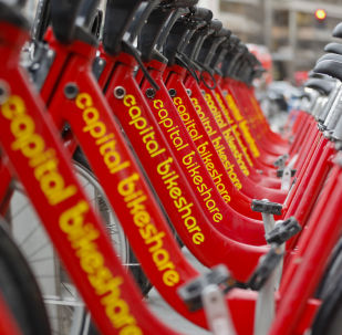 Red bicycles from Capital Bikeshare are seen docked in downtown Washington, Wednesday, Feb. 14, 2018. (AP Photo/Pablo Martinez Monsivais)