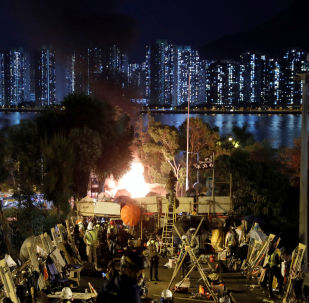 Protesters block Tolo Highway outside Chinese University campus in Hong Kong