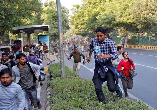 Police wield their batons against students of Jawaharlal Nehru University (JNU) during a protest against a proposed fee hike, in New Delhi, India, November 18, 2019