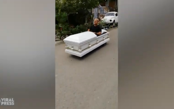 Creative Motorist Drives 'Coffin-Mobile' Through Philippines