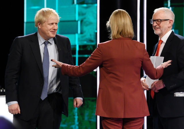 Conservative leader Boris Johnson and Labour leader Jeremy Corbyn are seen during a televised debate ahead of general election in London, Britain, November 19, 2019