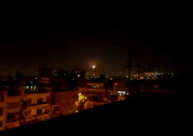 Light in the sky, believed to be a missile, is seen the city in Damascus, Syria November 20, 2019