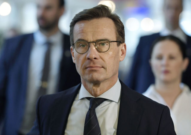 Ulf Kristersson, lesder of the center-right party Moderates, makes his way to a press meeting in the Riksdag, Stockholm, Wednesday Nov. 14, 2018