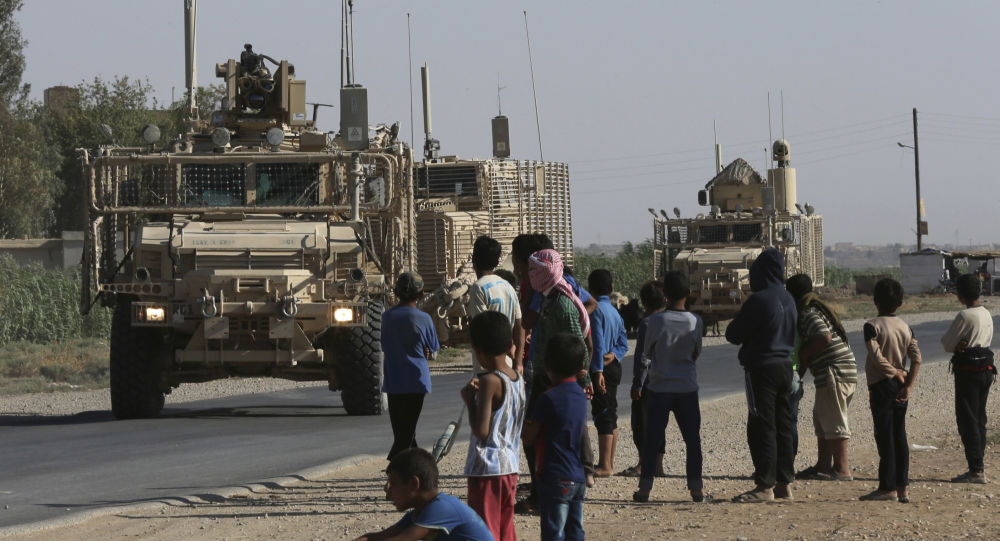SANA: US Transfers Weaponry and Logistic Gear to Syria From Iraq