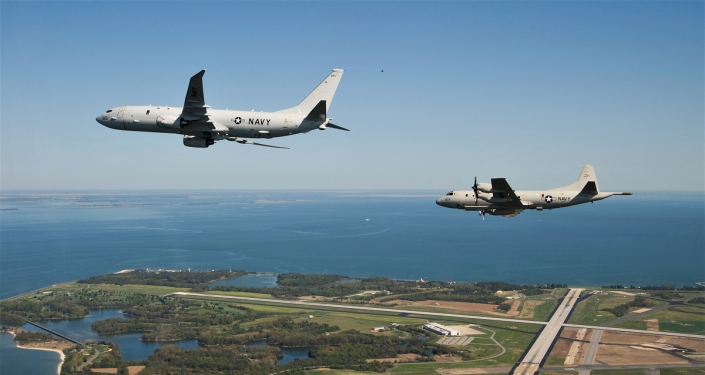 Russian MiG-31 Fighter Jet Escorts US R-8A Poseidon Aircraft Over Pacific Ocean