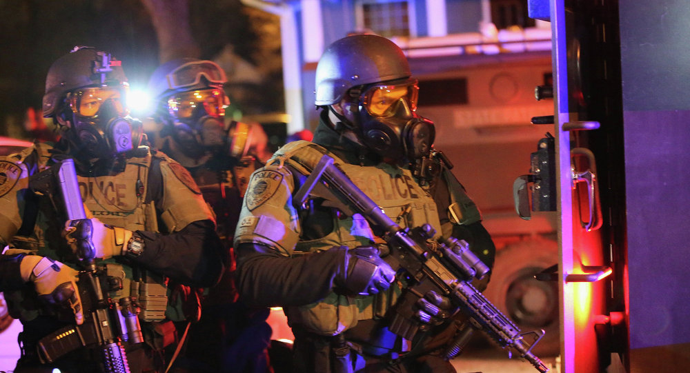US Attorney General claims that the use of combat military equipment by local law enforcement in Ferguson, heightened tensions during the summer protests