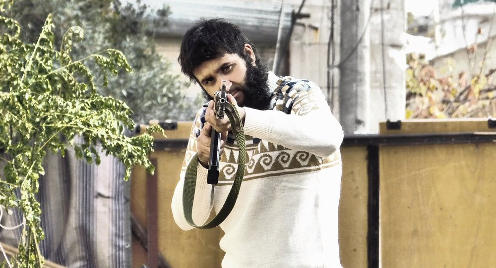 Yusef Sarwar holding a gun