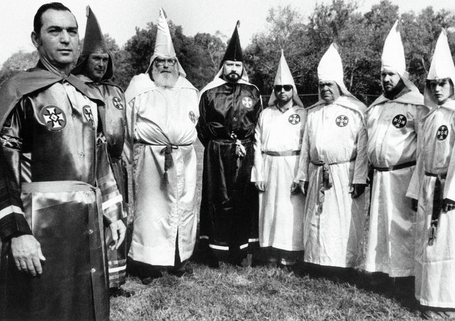 Tony La Ricci, far left, the head of the Maryland Independent Knights of the Ku Klux Klan, stands with seven members of the Klan, including Ron Glover, the fourth from the left in Baltimore, Nov. 12, 1979.